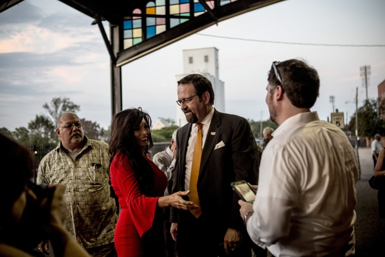 Image: Sebastian Gorka, former deputy assistant to President Donald Trump, mingles with fans at the debate watching party for Moore.