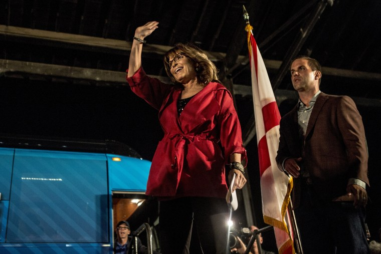 Image: Former Alaska governor and vice presidential candidate Sarah Palin emerges from the Great America Alliance bus to address attendees of the rally.