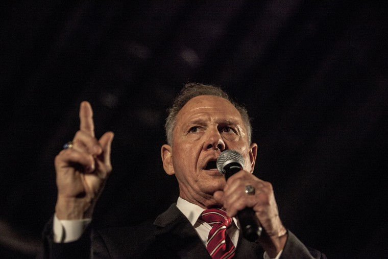 Image: Republican candidate for Senate Roy Moore speaks at a rally at Train Depot in Montgomery, Alabama on September 21, after having debated his opponent, Luther Strange, earlier that evening.