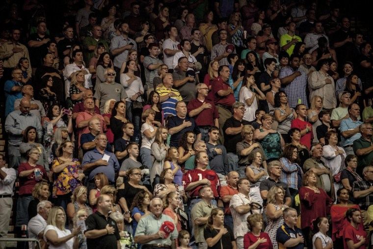 Image: People recite the Pledge of Allegiance at a rally for Luther Strange, a Republican candidate for Senate, at the Von Braun Center in Huntsville, Alabama on Sept. 22, 2017.