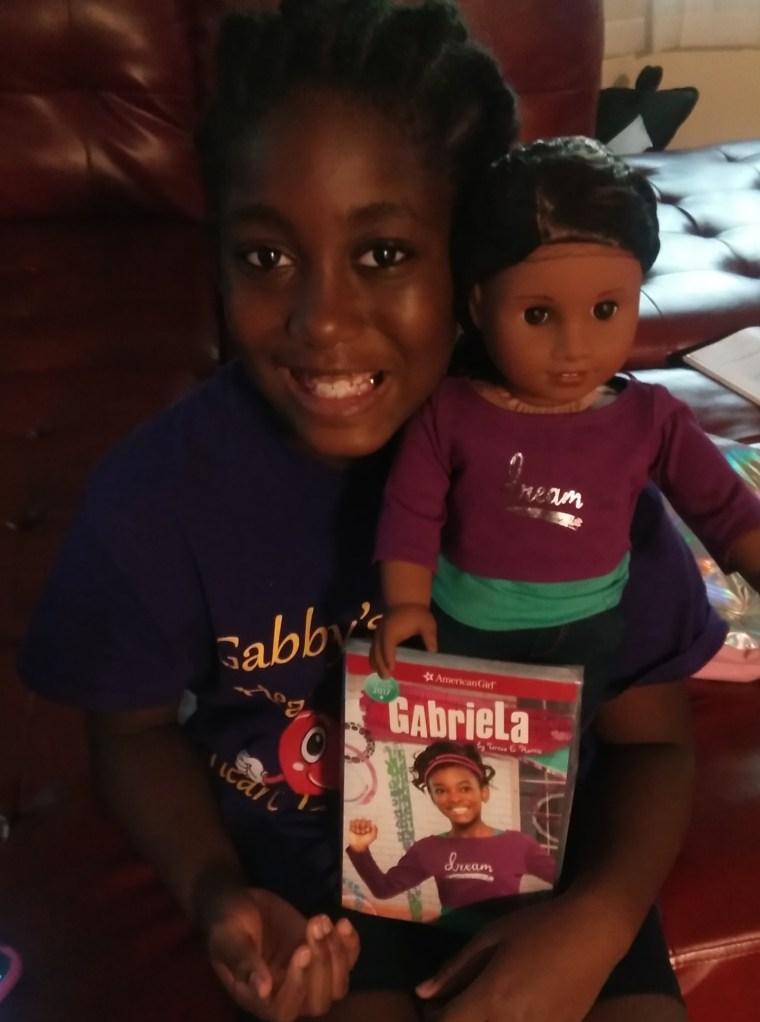 Gabrielle with her Gabriela doll.