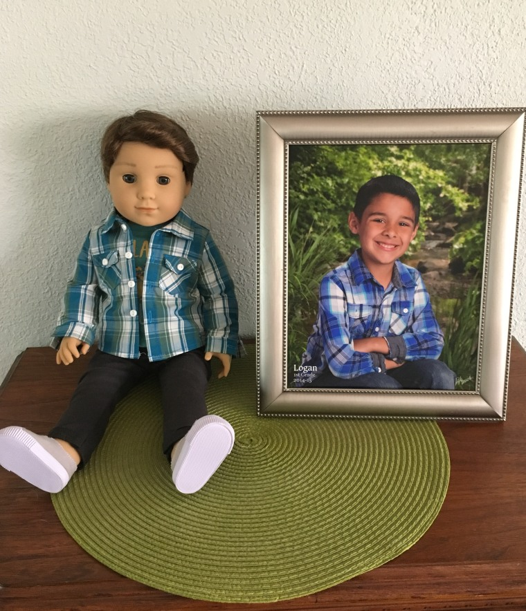 Fortson's Logan doll with her son's school photo.
