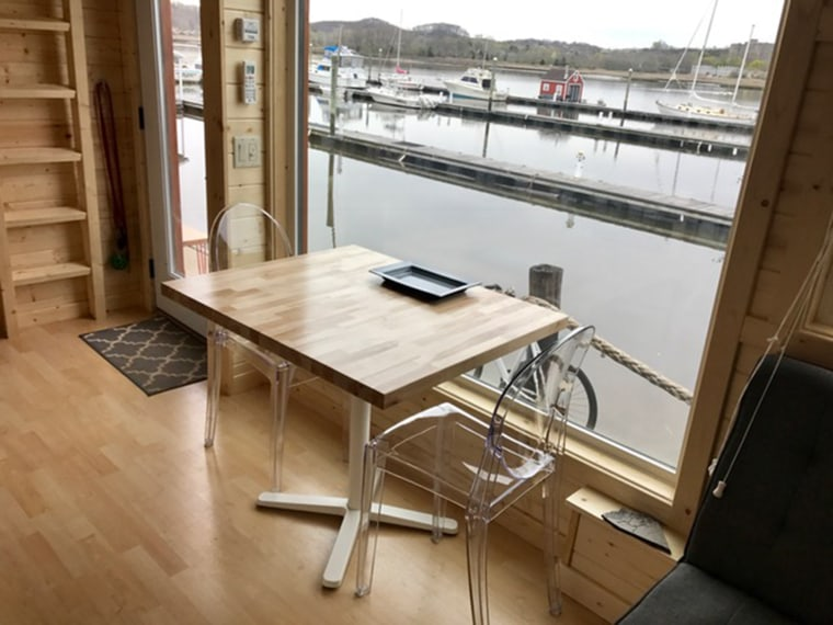 Two Pilates instructors decided to leave their stressful city life behind and downsize to a 344-square-foot retreat on the water.