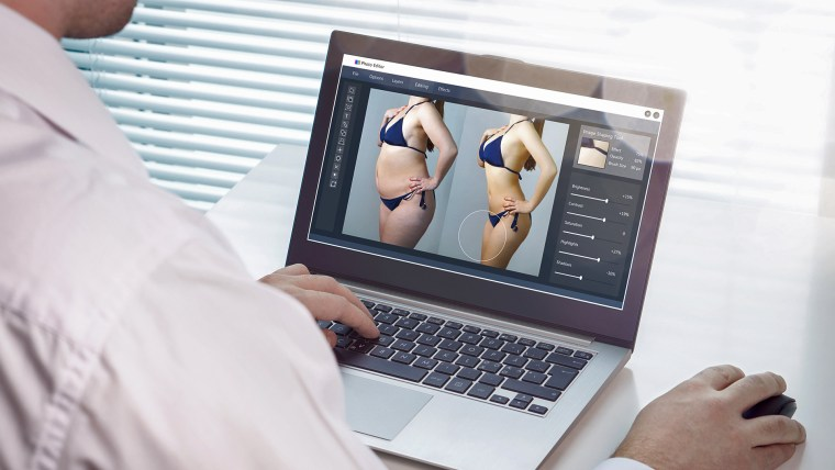Editor retouching an image
