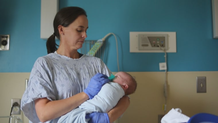 A nurse in the neonatal intensive care unit at Niswonger Children's Hospital comforts an infant born with neonatal abstinence syndrome, or NAS. Wracked by the opioid crisis, Northeastern Tennessee has one of the highest rates of NAS, and the hospital recently built a new ward to care for the increasing number of children born dependent on opiates.