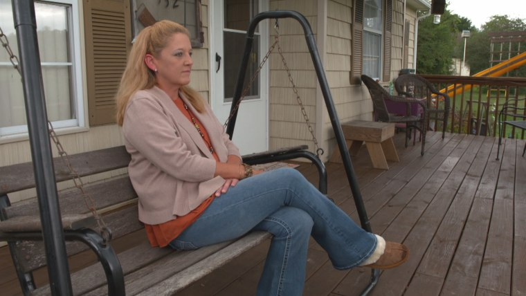 """Libby Harris, 45, sits at her home in Campbell County, Tennessee. Her 17-month-old granddaughter was born with neonatal abstinence syndrome. """"I've many times thought, Golly. I just don't understand why I'm the only one dealing with this. But once you open your eyes to it, and you start speaking to it, you find out really fast, you're not alone. It's everywhere."""""""