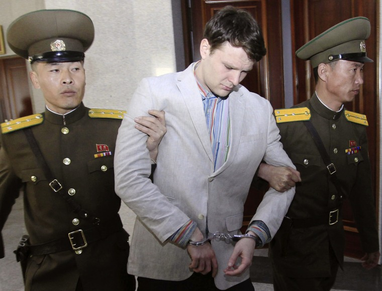 Image: Otto Warmbier is escorted at the Supreme Court in Pyongyang