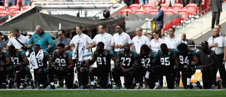 Jacksonville Jaguars players kneel during the national anthem as they prepared to play against the Baltimore Ravens at Wembley Stadium in London, England, on Sunday.