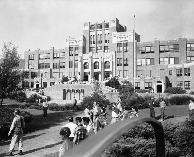 Students and members of the National Guard outside Central High School in Little Rock, Ark., weeks before nine black students entered the school protected by members of the 101st Airborne.