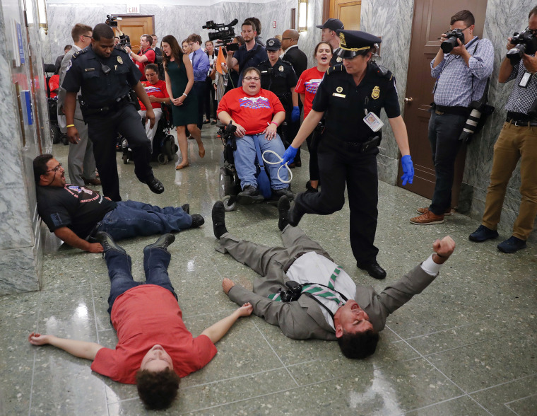 Image: U.S. Capitol Police detain protesters laying on the ground