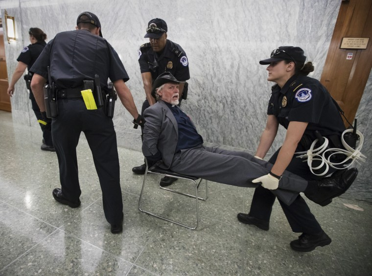 Image: Activists opposed to the GOP's Graham-Cassidy health care repeal bill, many with disabilities, are removed by U.S. Capitol Police