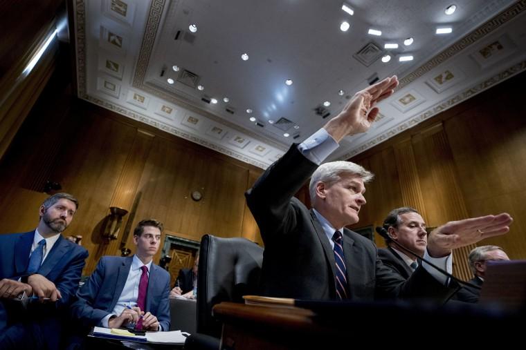 Image: Sen. Bill Cassidy, R-La., second from right, accompanied by Former Pennsylvania Sen. Rick Santorum, right, testifies
