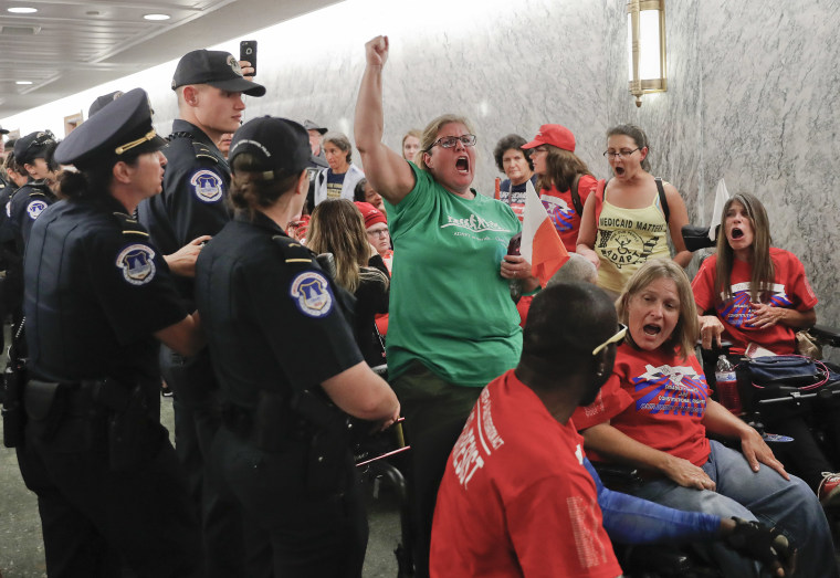 Image: A woman begins to yell as U.S. Capitol Police are about to detain her