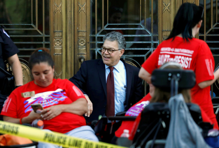 Image: Sen. Al Franken tries to enter Dirksen Senate Office Building as Capitol Police detain demonstrators as the Senate Finance Committee holds a hearing on the latest Republican Effort to repeal and replace the Affordable Care Act on Capitol Hill in Wa