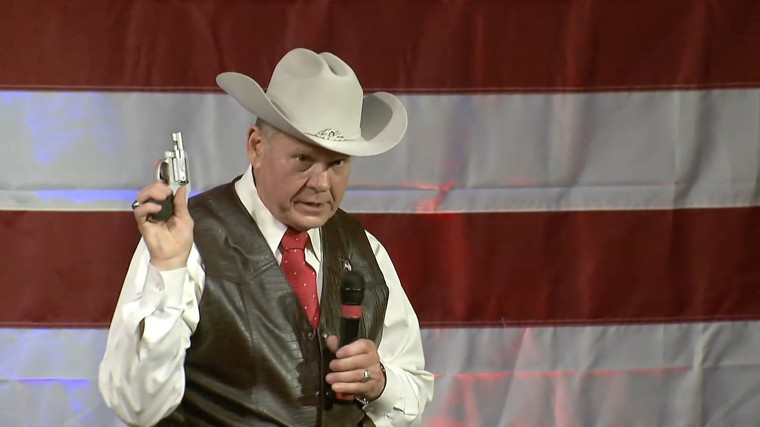 Image: Roy Moore Pulls Revolver While On STage