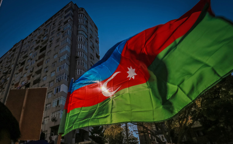Azerbaijani opposition supporters holds an Azerbaijan flag
