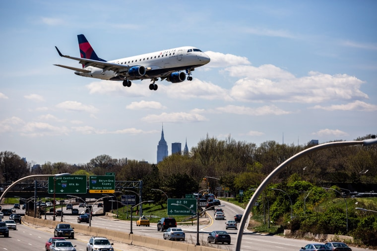Image: A Delta plane prepares for landing at LaGuardia Airport in New York