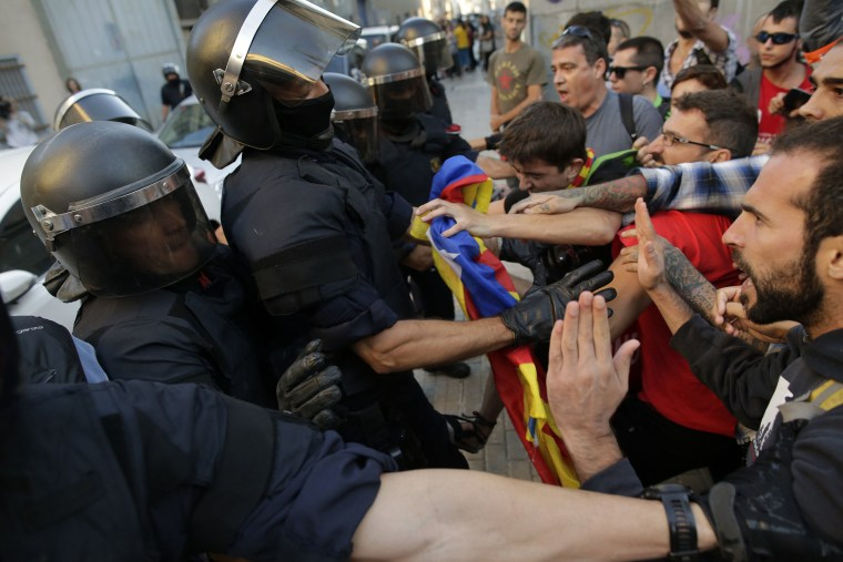 Image: Catalan police scuffle with protesters