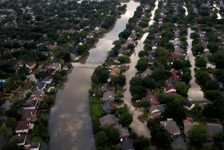 Image: FILE PHOTO: Houses are seen partially submerged in flood waters caused by Tropical Storm Harvey in Northwest Houston