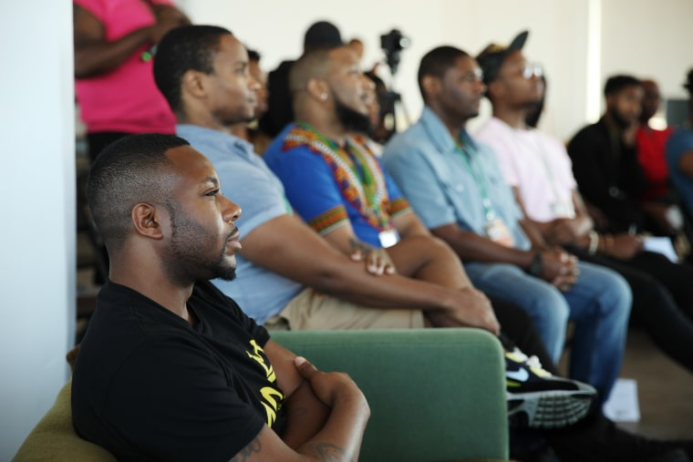 DaShawn Usher, founder of the Mobilizing Our Brothers Initiative, listening to a MOBItalk.