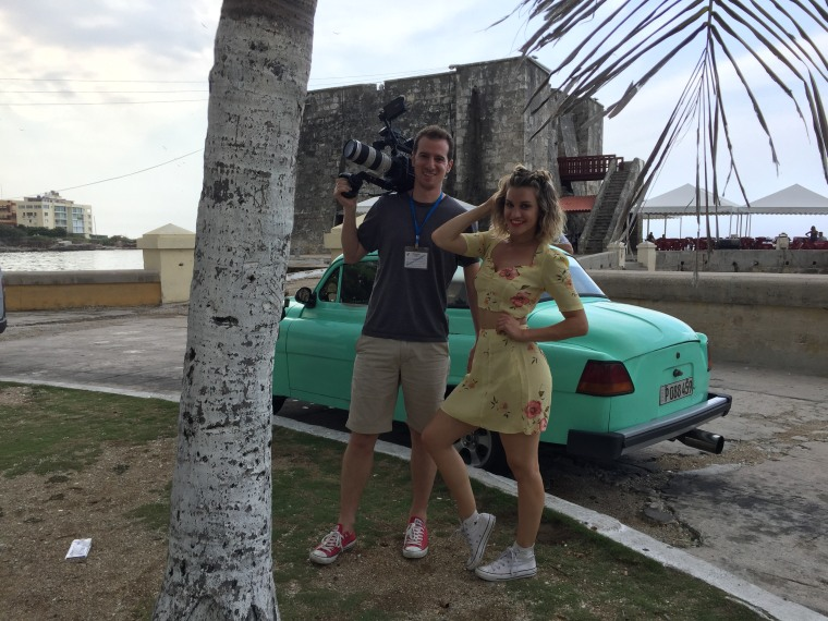 '1st Look' director and senior producer Brian Mait and host Ashley Roberts on the famed Malecon, which stretches along the coast in Havana.