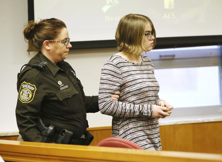Image: Morgan E. Geyser is escorted into a Waukesha County Court