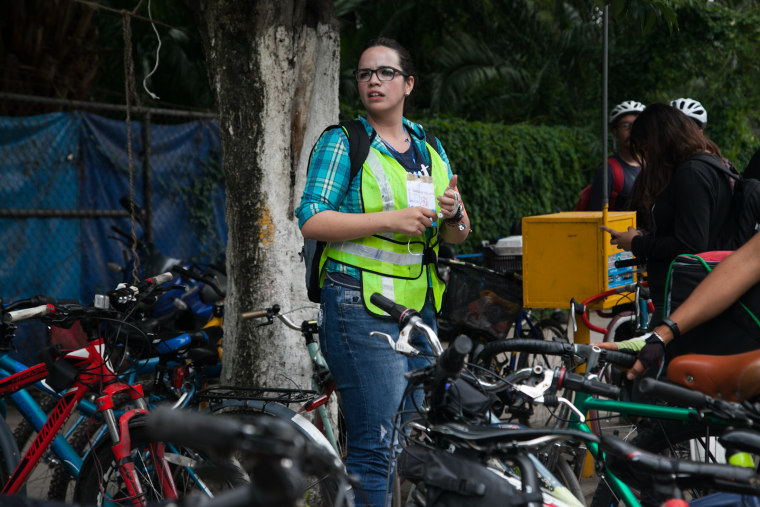 A volunteer at the Roma neighborhood in Mexico City gives instructions to a cyclist brigade as they prepare to deliver supplies following the earthquake.