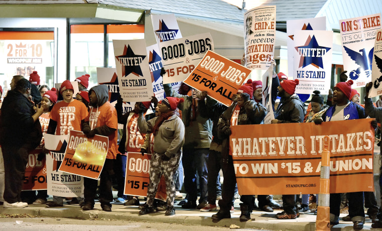 Image: Protesters gather in front of a Burger King in the 3400 block of Main Street