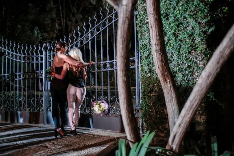 Image: Hugh Hefner fans gather at the gate of the Playboy Mansion in Los Angeles