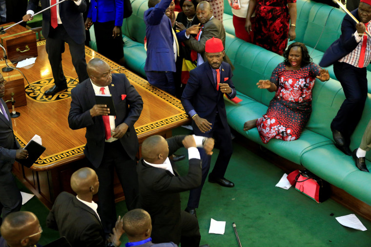 Image: Ugandan opposition lawmakers fight with plain-clothes security in parliament in Kampala