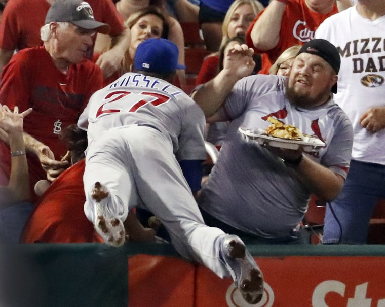 Image: Chicago Cubs shortstop Addison Russell dives into the crowd but is unable to catch a foul ball
