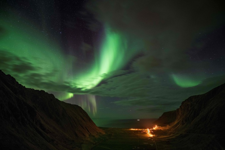 Image: Northern lights are visible on Unstad's bay in the arctic circle
