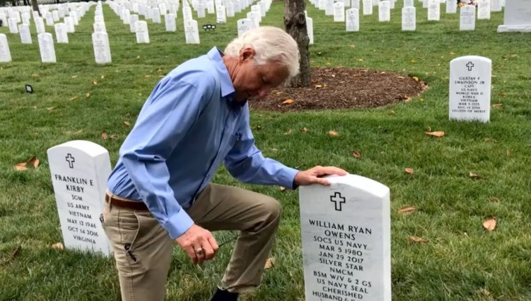 Image: Bill Owens kneels at the gravestone of his son, Ryan Owens.