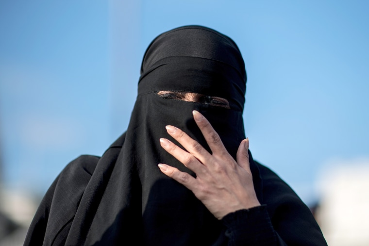 Image: A protester wears a niqab during a demonstration against a full-face veil ban in Vienna, Austria on Oct. 1, 2017.