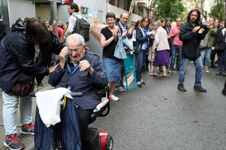 Image: A Catalan man reacts after voting in the '1-O Referendum' at the Escola Jaume I school, in Barcelona.