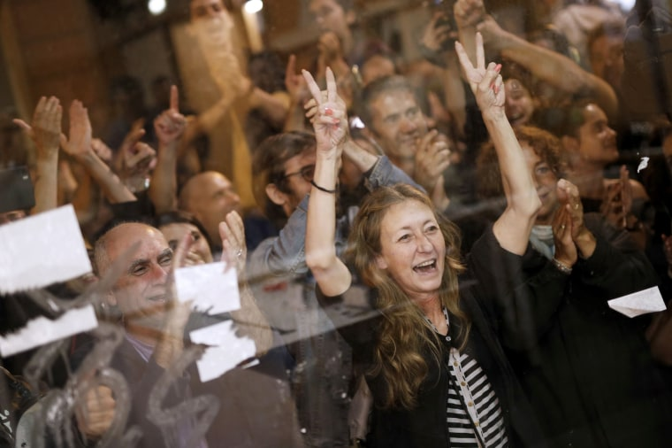 Image: People celebrate after the closing of polling stations outside of the 'Espai Jove La Fontana' (La Fontana youth center).