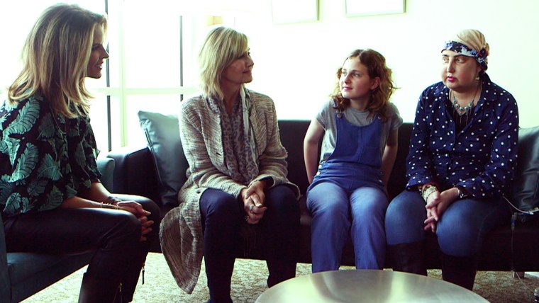 Olivia Newton-John speaks with cancer patients at the research center she founded.