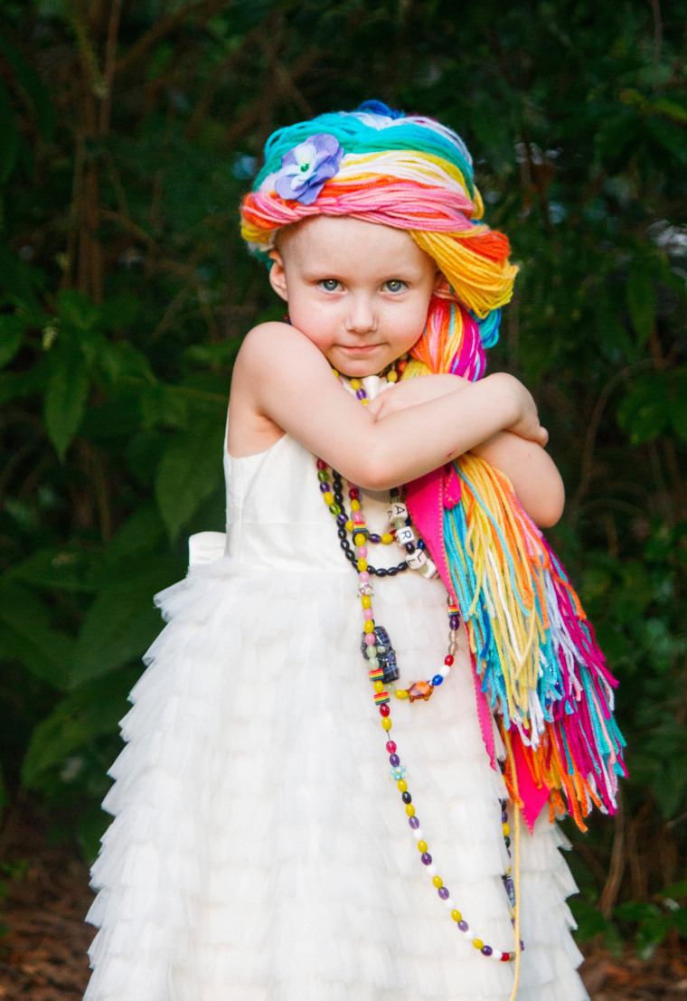 Arli loves her rainbow wig.