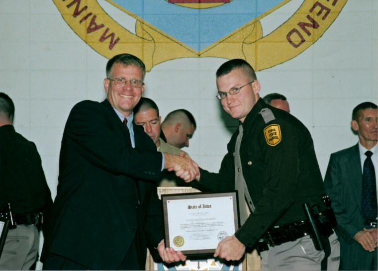 Mike Haugen is sworn in as an Iowa State Patrolman in 2006.