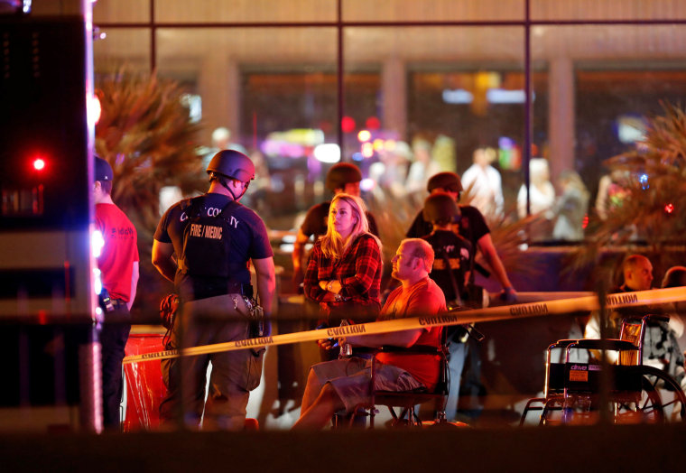 Image: People wait in a medical staging area on October 2, 2017, after a mass shooting at a music festival in Las Vegas