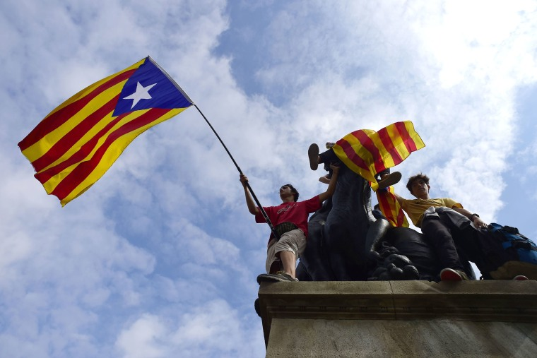 Image: Protesters wave Catalan pro-independence flags