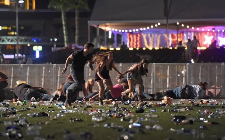 Image:  People run from the Route 91 Harvest country music festival