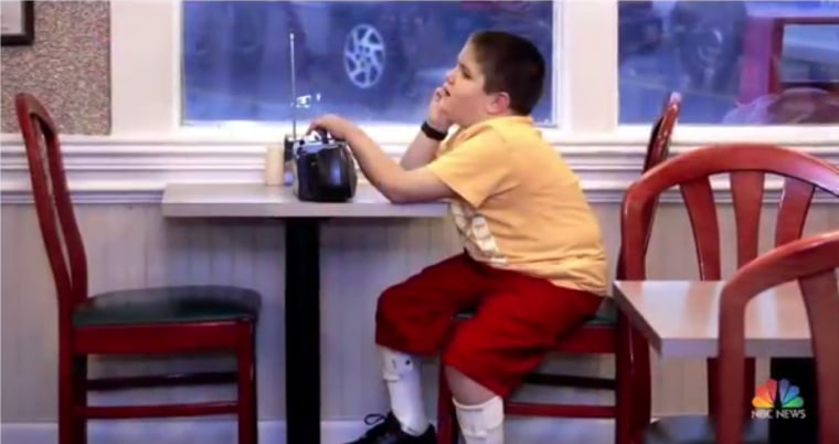HK Derryberry as a little boy in a Mrs. Winner's restaurant listening to his radio