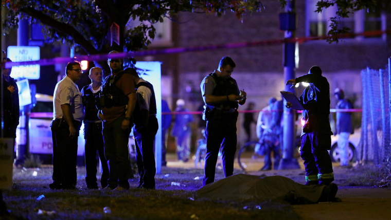 Police and fire officials inspect the scene of a fatal shooting on Sept. 29, 2017, in Chicago.