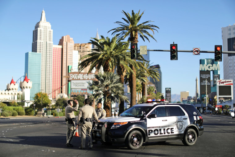 Image: Police stand in front of the closed Las Vegas Strip next to the site of the Route 91 music festival mass shooting outside the Mandalay Bay Resort and Casino in Las Vegas