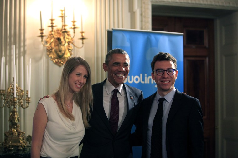 Duolingo co-founder Luis von Ahn poses for a photo at the White House with President Barack Obama.