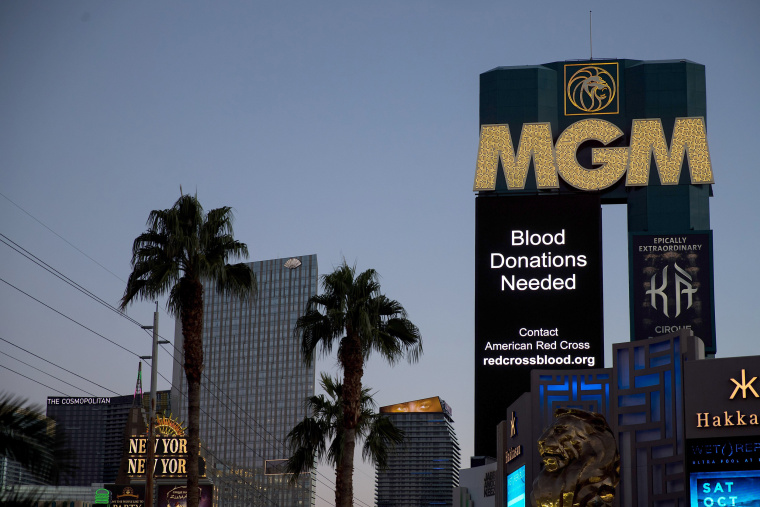 Image: A message about blood donations for the victims of Sunday night's mass shooting is displayed on the marquee of the MGM Grand Hotel and Casino