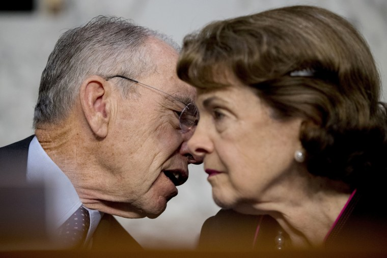 Image: Chairman Sen. Chuck Grassley, R-Iowa, and Sen. Dianne Feinstein, D-Calif., right, speak  during a Senate Judiciary Committee hearing