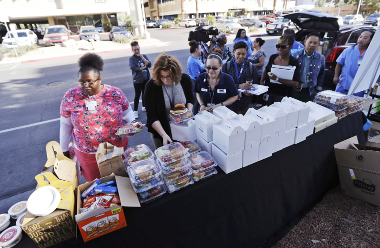 Image: Healthcare workers from UMC Hospital in Las Vegas line up for free food
