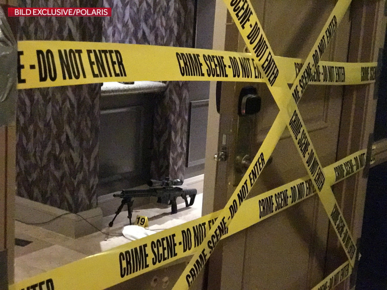 Image: Crime scene tape lines the door of gunman Stephen Paddock's suite on the 32nd floor of the Mandalay Bay Resort and Casino in Las Vegas